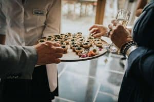 Guests at a Private Party take canapés and enjoy catering.